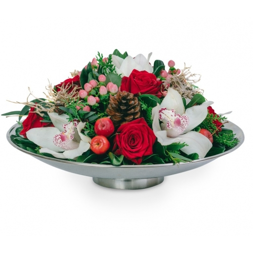 Arrangement with orchids and roses in a plate