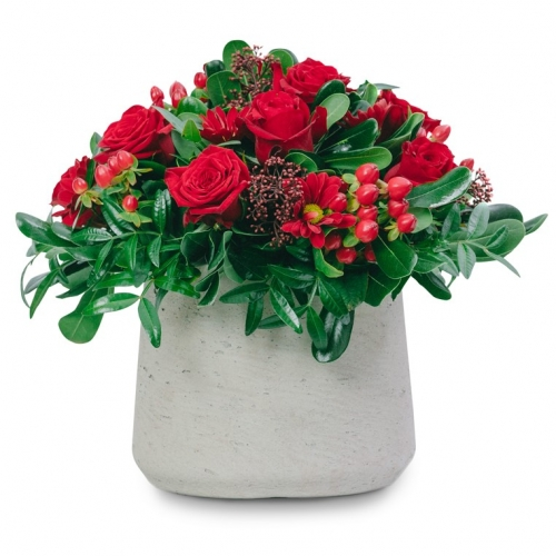 Red arrangement in a stone pot