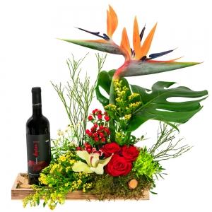 Ανθοσύνθεση με λουλούδια και κρασί