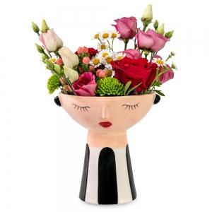 Ροζ λουλούδια σε γαλήνιο προσωπάκι