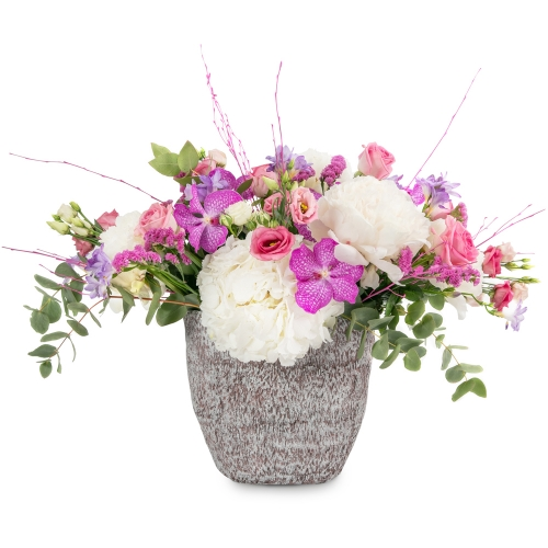 Hydrangea, orchids and eustoma in a special stone vaze